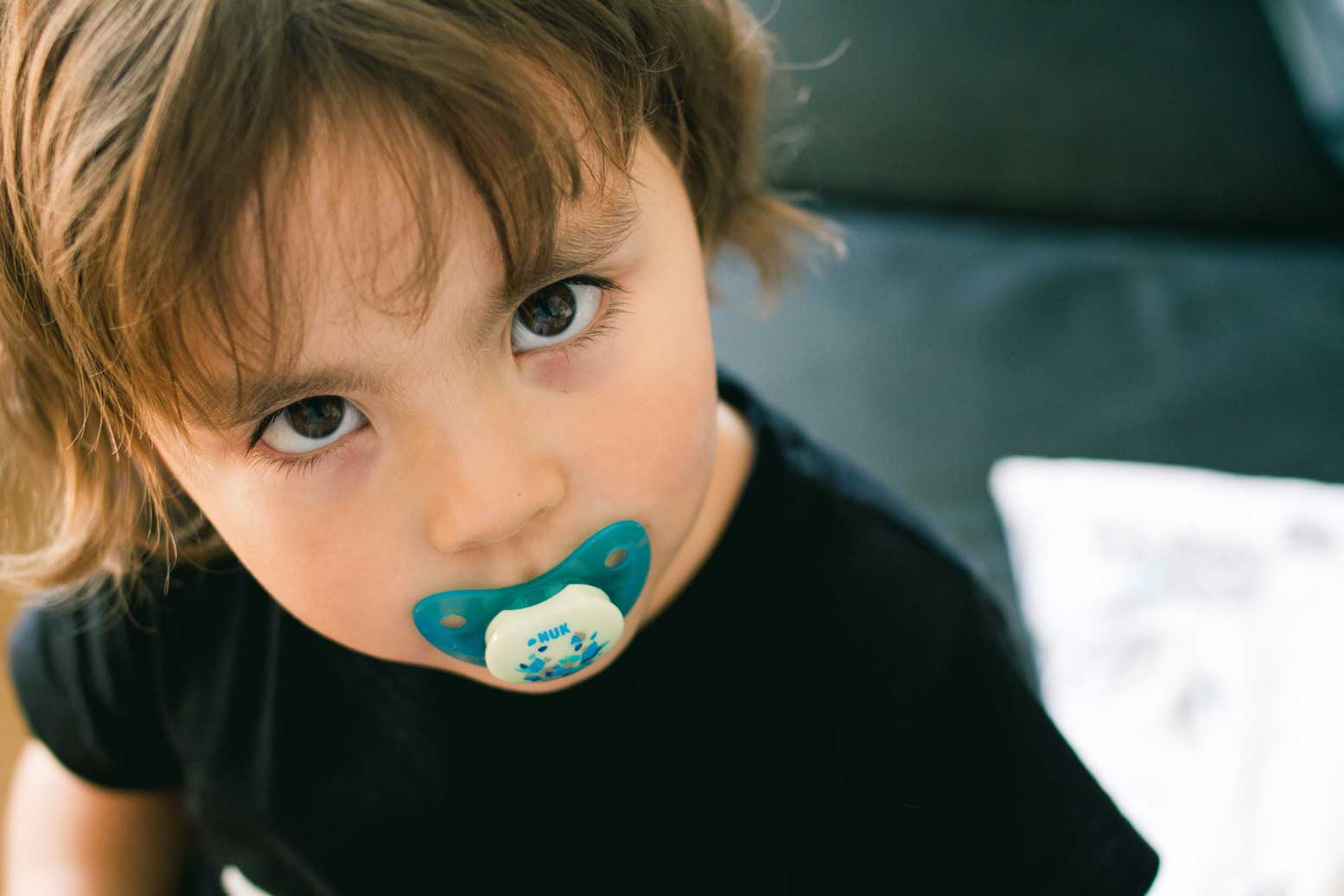 Little Kid with pacifier.